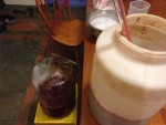Transferring batch 1 off the pulp after primary fermentation